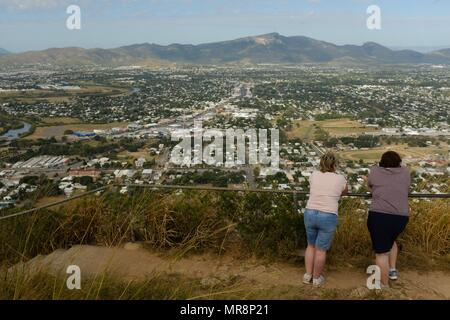 Two women enjoying the view from the top of castle hill, Castle Hill QLD 4810, Australia - Stock Photo