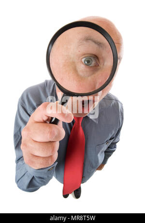 An inspector looking through a magnifying glass. - Stock Photo