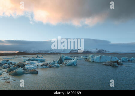 majestic icelandic landscape with melting icebergs in cold water, Iceland, Jokulsarlon lagoon - Stock Photo