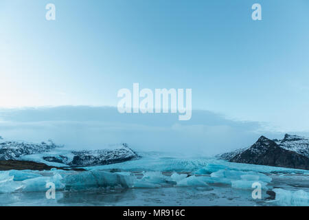 beautiful icelandic landscape with melting icebergs in cold water, Iceland, Jokulsarlon lagoon - Stock Photo
