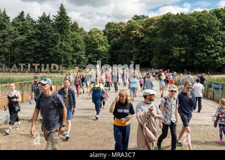 Crowds entering the main arena on a sunny first morning at Latitude Festival. Henham Park, Suffolk, UK. - Stock Photo