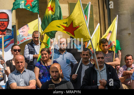 London, UK. 26th May 2018. Kurds and supporters hold a short rally outside the BBC before marching to Downing St and Parliament Square to call for an end to the Turkish occupation of Afrin. Some hold flags of the Kurdish Defence fooreces YPG and YPJ and of imprisoned nationalist leader Ocalan. ircled and have vowed to continue the fight to regain Afrin through a guerilla war. Erdogan wants to attack other Kur Credit: Peter Marshall/Alamy Live News - Stock Photo