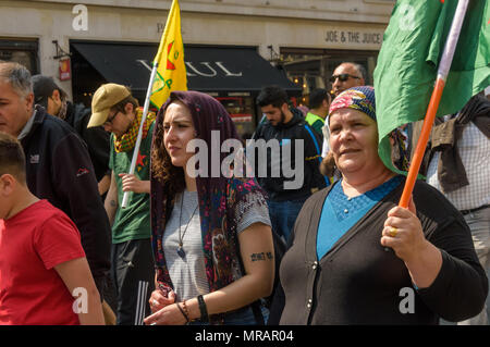 London, UK. 26th May 2018. Kurds and supporters march from their rally outside the BBC to Downing St and Parliament Square to call for an end to the Turkish occupation of Afrin. Some marchers wore traditional Kurdish headscarves or scarves and carried YPJ and YPG flags. ircled and have vowed to continue the fight to regain Afrin through a guerilla war. Erdogan wants to attack other Kurdish areas of Syria, but Credit: Peter Marshall/Alamy Live News - Stock Photo