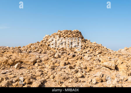 Ancient burial tombs in Barshaw on the outskirts of Muscat, Oman.  Tombs are formed using stones found littered on the ground - Stock Photo