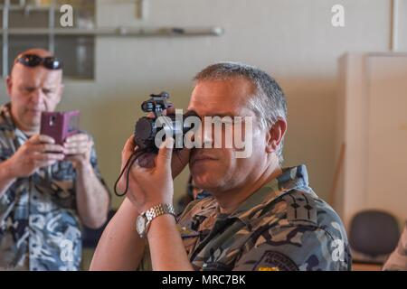 Col. Nikolay Lyaskovski, head of Force Protection in the Branch of Training Department for the Bulgarian Air Force, examines a night vision lens on May 31, 2017 at Berry Field Air National Guard Base, Nashville, Tenn. Tennessee partners with Bulgaria under the State Partnership Program, which is designed to train allied forces, build international relationships, and enhance regional security. (U.S. Air National Guard photo by Senior Airman Anthony Agosti) - Stock Photo