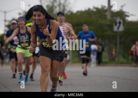 Brenna Cliver poses while running the Devil Dog Double, part of the 10th Annual Marine Corps Historic Half, (MCHH) Fredericksburg, Va., May 21, 2017. The MCHH attracts over 8,000 participants and features the Marine Corps Semper 5ive and the Devil Dog Double. (U.S. Marine Corps photo by Sgt. John M. Raufmann) - Stock Photo