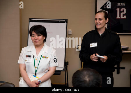 170605-N-JD834-018 NAVAL AIR FACILITY ATSUGI, Japan (June 5, 2017) Aviation Electronics Technician 2nd Class Teresa Domingo, right, introduces Japan Maritime Self-Defense Force (JMSDF) Aviation Electronics Technician 2nd Class Yukiko Sato during the U.S./JMSDF Bilateral Non-Commissioned Officer Leadership Continuum. The course will last three days and will have service members discuss topics such as leadership, destructive behaviors, harassment, and women in the workplace.  (U.S. Navy Photo by Mass Communication Specialist 2nd Class Michael Doan/RELEASED) - Stock Photo