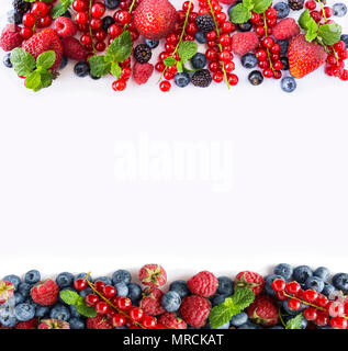Black-blue and red fruits. Ripe red currants, strawberries, raspberries, blackberries, blueberries and blackcurrants on white background. Berries at b - Stock Photo