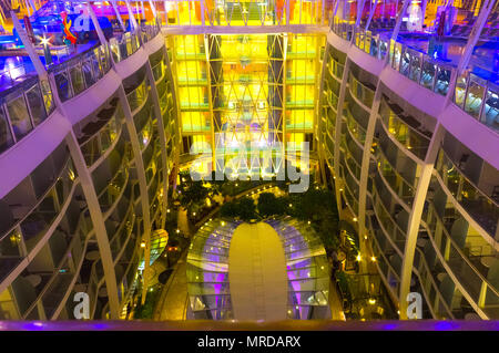 Cape Canaveral, USA - May 06, 2018: Open deck in the night time. Giant cruise ship Oasis of the Seas by Royal Caribbean. - Stock Photo