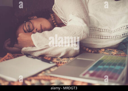 lonely beautiful caucasian woman sleep after a strong hard work at home with laptop. no hours problem working at home instead that an usual office. al - Stock Photo