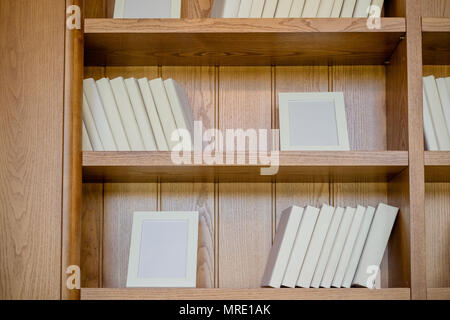 Books. A lot of books with bright white covers isolated on wooden background. Design element, paper and leather texture. white books on the shelf.stack of books on the wooden shelves - Stock Photo