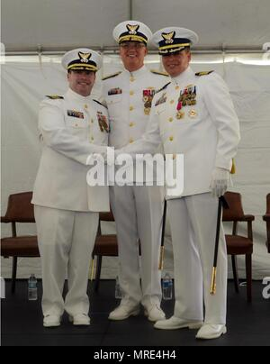 From left to right: Capt. Eric P. King, new Sector San Juan commander, Rear Adm. Scott A. Buschman, Coast Guard's Seventh District commander, and Capt. Robert W. Warren, outgoing commander, during Sector San Juan's change of command ceremony June 9, 2017. King will be leading approximately 650 active duty, reserve and civilian men and women who conduct Coast Guard missions in the Eastern Caribbean. (Photo by Ricardo Castrodad, Sector San Juan public affairs specialist) - Stock Photo