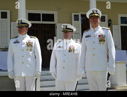 From left to right: Capt. Robert W. Warren, Sector San Juan's outgoing commander; Capt. Eric P. King, Sector San Juan incoming commander; and Rear Adm. Scott A. Buschman, Coast Guard's Seventh District commander, during the unit's change of command ceremony June 9, 2017. During his previous assignment, King was the Chief of the Training Department at the Coast Guard Training Center in Petaluma, California. He will now be leading approximately 650 active duty, reserve and civilian men and women who conduct Coast Guard missions in the Eastern Caribbean. (Photo by Ricardo Castrodad, Sector San Ju - Stock Photo