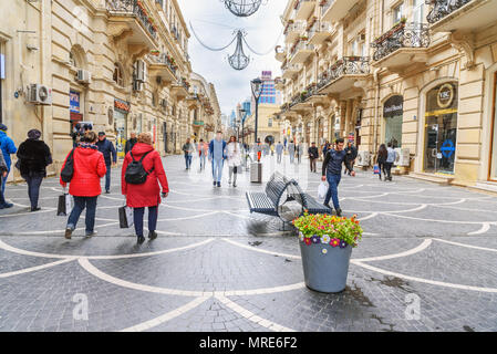 Baku, Azerbaijan - March 10, 2018: People walk in Nizami street in ceter of city in spring. - Stock Photo