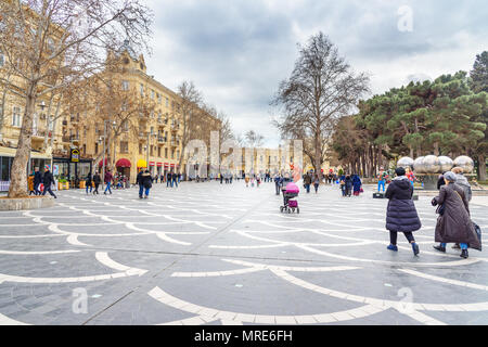 Baku, Azerbaijan - March 10, 2018: People walk on Fountain square in center of city in spring - Stock Photo