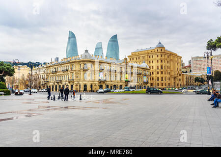 Baku, Azerbaijan - March 10, 2018: View of city with Flame Towers from Seaside boulevard in spring - Stock Photo