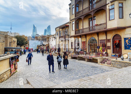 Baku, Azerbaijan - March 10, 2018: Street in Old city,Icheri Sheher is the historical core of Baku. And view of Flame Towers - Stock Photo