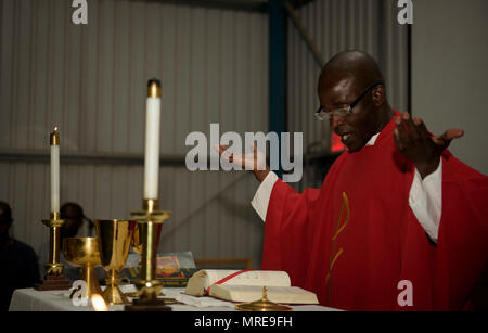 Chaplain (Capt.) John Appiah, 455th Air Expeditionary Wing, gives a sermon during an observance of the Uganda Martyrs at Bagram Airfield, Afghanistan, June 3, 2016. The Bagram Chapel team does its best to accommodate all and provides the necessary religious services for every religion. Bagram has a large population of Ugandan workers, so the Chapel team put together a religious service for them, which observed the Ugandan Martyrs. (U.S. Air Force photo by Staff Sgt. Benjamin Gonsier)
