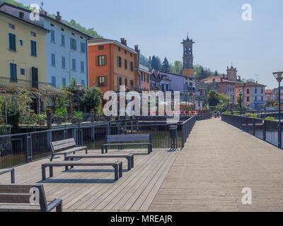 long walk on the suggestive Italian side of Lugano Lake, Porto Ceresio Italy - Stock Photo