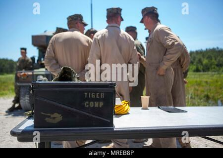 U.S. Marines with Bravo Company, 1st Tank Battalion, 1st Marine Division (1ST MARDIV), Alpha Company, 2nd Tank Battalion, 2d Marine Division (2D MARDIV), and Alpha Company, 4th Tank Battalion, 4th Marine Division (4TH MARDIV) prepare to be awarded during the 14th annual Tiger Competition (TIGERCOMP) at SR-10 range on Camp Lejeune, N.C., June 9, 2017. The purpose of TIGERCOMP is to test each Marine tank crew's decision-making abilities, communication, technical proficiency and cohesiveness while operating the M1A1 Abrams tank. (U.S. Marine Corps photo by Lance Cpl. Angel Travis) - Stock Photo