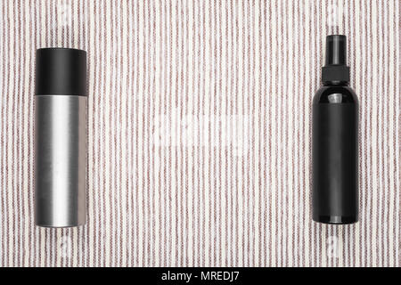 two bottles of hair treatment liquids - Stock Photo