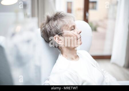 Senior woman with nasal cannula. - Stock Photo