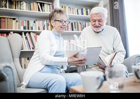 Senior couple reading books. - Stock Photo