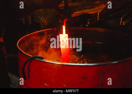 Work carried out in the thermal tempering metal workshops - Stock Photo