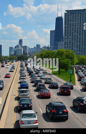 Cars heading into downtown Chicago are stuck in traffic on Lake Shore Drive over the Memorial Day weekend. - Stock Photo