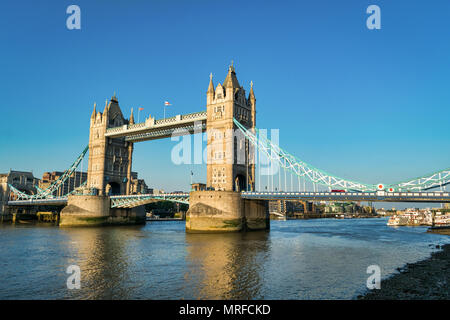 The Iconic Tower Bridge in London spanning the Thames River - Stock Photo