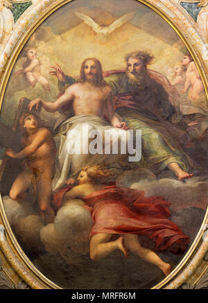 PARMA, ITALY - APRIL 17, 2018: The painting of Holy Trinity on tha main altar in church Chiesa di Santa Teresa by Antonio Ilarioli from 19. cent. - Stock Photo