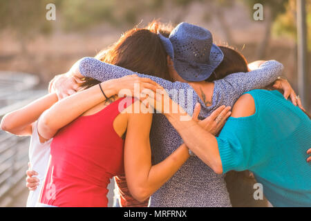 union all togehter like a team work and group of friends females 7 beautiful women hug all together under the sunlight and sunset for friendship and r - Stock Photo