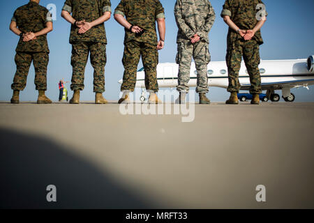 From left to right, 1st Lt. Alexandra R. Bello, public affairs officer, Lt. Col. Allen Laughlin, executive officer of Special Purpose Marine Air-Ground Task Force-Crisis Response-Africa, SgtMaj. John J. Elliot, the SPMAGTF-CR-AF sergeant major., Air Force Maj. Matthew Wallaart, commanding officer of the 496th Fighter Wing, and Col. Sean M. Salene, the commanding officer of SPMAGTF-CR-AF, send off Gen. Glenn M. Walters, the Assistant Commandant of the Marie Corps, on Morón Air Base, Spain, June 1, 2017. SPMAGTF-CR-AF deployed to conduct limited crisis-response and theater-security operations in - Stock Photo