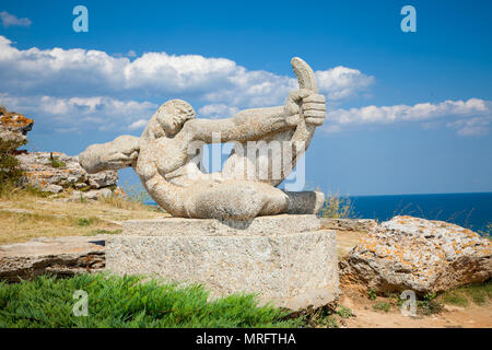 Stone statue in the medieval fortress on cape Kaliakra, Bulgaria. - Stock Photo