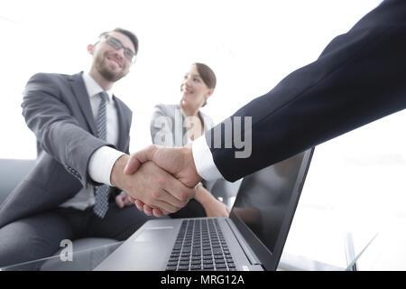 closeup. confident handshake colleagues - Stock Photo