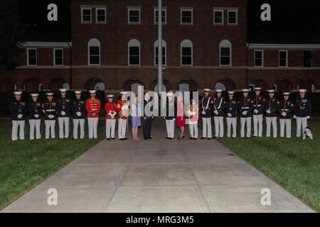 Secretary of the Navy the Honorable Sean J. Stackley, center left, and the Commandant of the Marine Corps Gen. Robert B. Neller, center right, pose for a photo with U.S. Marines from Marine Barracks Washington following an evening parade at Marine Barracks Washington, Washington, D.C., June 9, 2017. Evening parades are held as a means of honoring senior officials, distinguished citizens and supporters of the Marine Corps. (U.S. Marine Corps photo by Cpl. Christian Varney) - Stock Photo