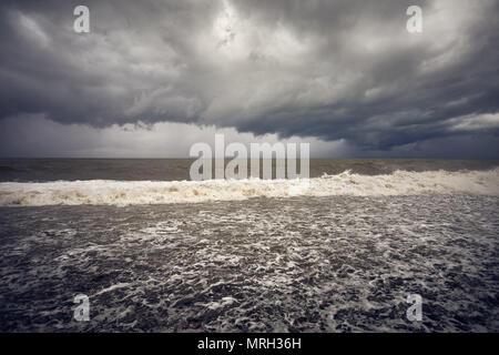 Dark clouds and stormy Black Sea in Batumi, Georgia - Stock Photo