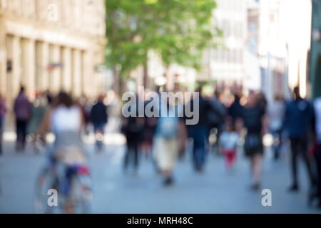 Blurred abstract people crowd background, unrecognizable silhouettes walking on a city street in a busy hour. Business concept. - Stock Photo