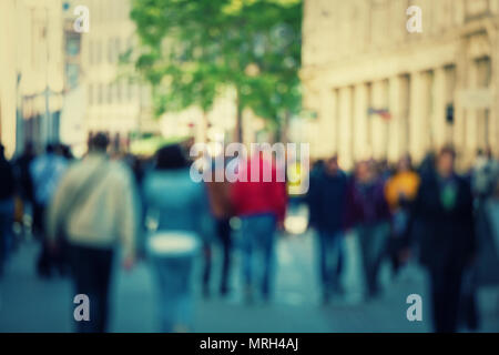 Abstract people crowd background with blur effect applied. Unrecognizable man and woman silhouettes walking on a city street in a busy hour. Business  - Stock Photo