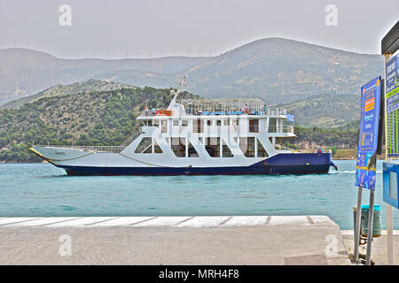 The vehicle & passenger ferry sets of from Argostoli harbour heading for Lixouri to save a long coastal road journey - Stock Photo