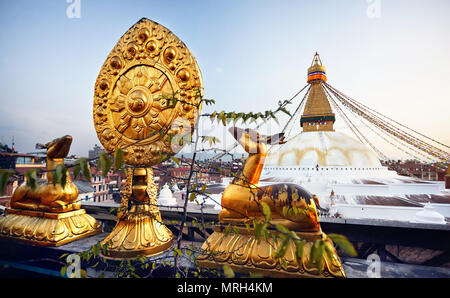 View of Bodnath Buddhist Stupa and Golden deers with leaf at the roof of monastery in Kathmandu - Stock Photo
