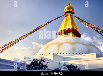 Bodnath Great Buddhist Stupa with prayer flags in Kathmandu - Stock Photo