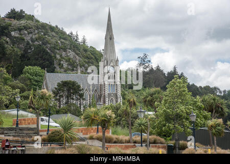Port Chalmers, Dunedin, New Zealand-December 11,2016:  Iona Church with mountain backdrop under a cloudy sky in Dunedin, New Zealand - Stock Photo