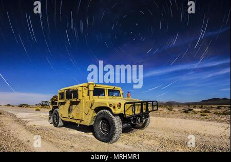 A 99th Civil Engineer Squadron explosive ordnance disposal team Humvee sits under the stars during a training exercise at the Nevada Test and Training Range June 7, 2017. The Humvee is the military's premier light armored truck and has multiple modifications that best suits each unit's specific needs. (U.S. Air Force photo illustration by Airman 1st Class Andrew D. Sarver/Released) - Stock Photo