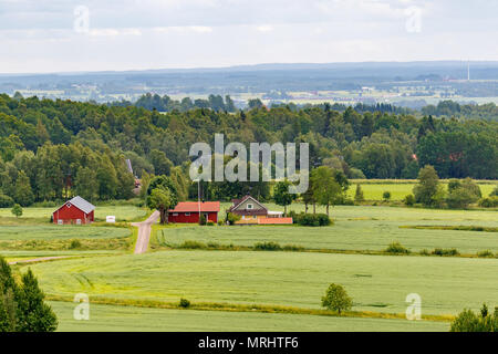 Rural landscape view with a farm on a field - Stock Photo