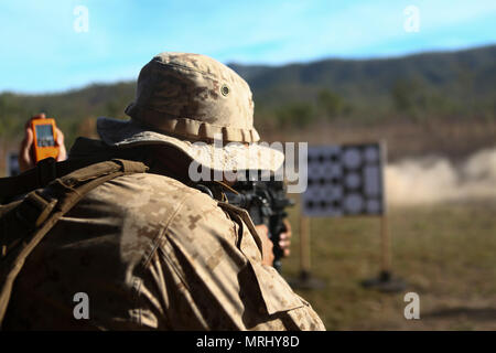 MOUNT STUART TRAINING AREA, Australia – A rifleman with