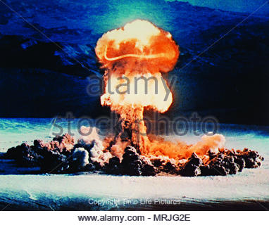 Photo of atomic explosion in the Nevada atomic bomb Test Site. Circa 1957 Editorial use only. - Stock Photo