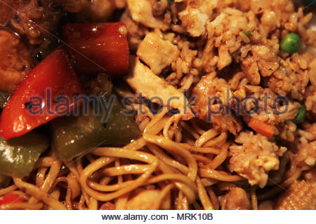 Hakka-style chow mein with shrimp fried rice and shrimp with black bean sauce. - Stock Photo