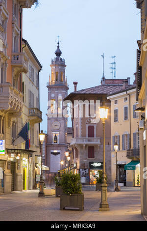 PARMA, ITALY - APRIL 16, 2018: The street of the old town at dusk. - Stock Photo