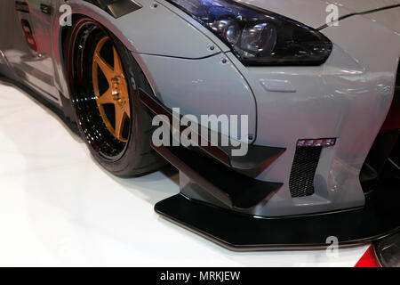 Close-up of the front of a  liberty Walk  modified Aston Martin, , on display at the 2018 London Motor Show - Stock Photo